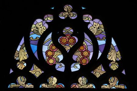 Art Nouveau floral pattern. Stained glass window in Saint Barbara Church in Kutna Hora, Czech Republic.
