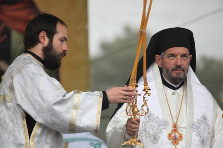 liturgy: MIKULCICE, CZECH REPUBLIC - MAY 25, 2013: Orthodox priests attend an orthodox service in honour of Saints Cyril and Methodius in Mikulcice, Czech Republic.