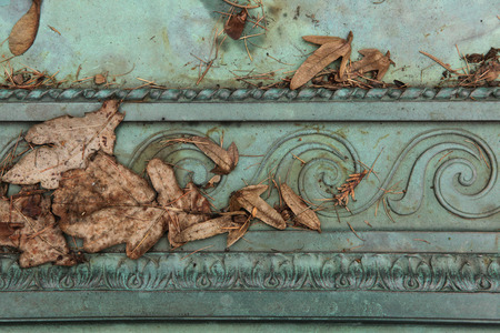 patina: Bronze ornamental pattern. Gravestone at an abandoned cemetery in Central Bohemia, Czech Republic. Stock Photo