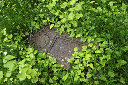olomouc: Fallen tombstone at an abandoned cemetery in Olomouc, Moravia, Czech Republic.