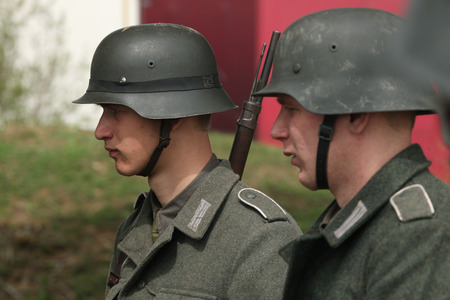 enact: ORECHOV, CZECH REPUBLIC - APRIL 27, 2013: Re-enactors dressed as German Nazi soldiers prepare to stage the Battle at Orechov (1945) near Brno, Czech Republic. The Battle at Orechov in April 1945 was the biggest tank battle in the last days of the World Wa Editorial