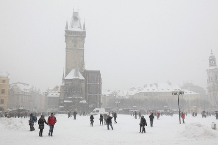 old town square: PRAGUE, CZECH REPUBLIC - FEBRUARY 23, 2013: Heavy snowfall covering the Old Town Hall on Old Town Square in Prague, Czech Republic. Editorial