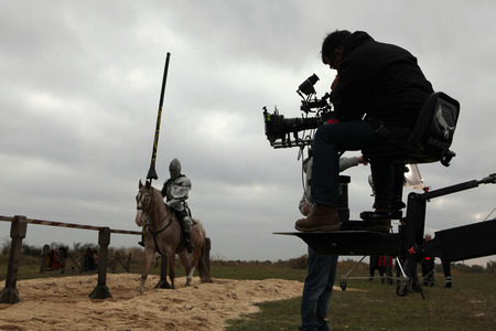 Films: MILOVICE, CZECH REPUBLIC - OCTOBER 23, 2013: Actor dressed as a medieval knight rides a horse during the filming of the new movie The Knights directed by Carsten Gutschmidt near Milovice, Czech Republic.