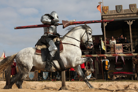 knight on horse: MILOVICE, CZECH REPUBLIC - OCTOBER 23, 2013: Medieval jousting competition during the filming of the new movie The Knights directed by Carsten Gutschmidt near Milovice, Czech Republic.