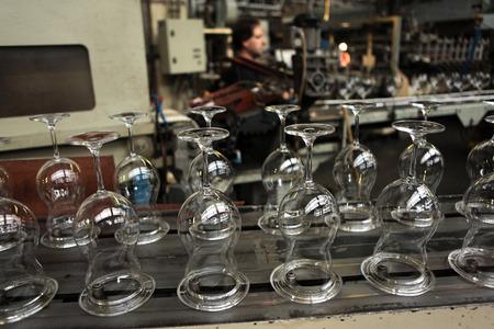 glasswork: SVETLA NAD SAZAVOU, CZECH REPUBLIC - NOVEMBER 7, 2014: Automatic production of machine blown stemware at the Bohemian glass factory Crystalite Bohemia in Svetla nad Sazavou, Czech Republic.