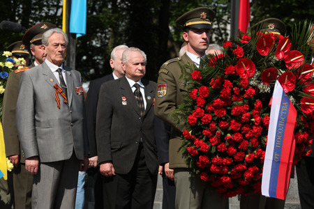 attend: PRAGUE, CZECH REPUBLIC - MAY 9, 2013: Soviet war veterans attend the celebration of Victory Day at the Soviet War Memorial at the Olsany Cemetery in Prague, Czech Republic.
