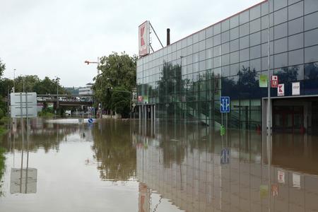 Swollen: PRAGUE, CZECH REPUBLIC - JUNE 3, 2013: Supermarket Kaufland flooded by the swollen Vltava River in Prague, Czech Republic.