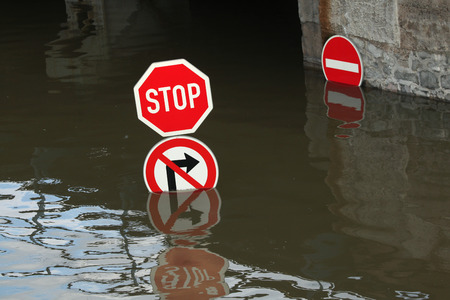 flood area sign: Stop and No right turn, traffic signs flooded by the swollen Elbe River in Usti nad Labem, Northern Bohemia, Czech Republic, on June 5, 2013. Stock Photo