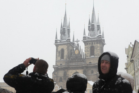old town square: PRAGUE, CZECH REPUBLIC - FEBRUARY 23, 2013: Heavy snowfall covering the Tyn Church on Old Town Square in Prague, Czech Republic. Editorial