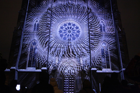 macula: PRAGUE, CZECH REPUBLIC - OCTOBER 17, 2013: People watch a projection mapping by Czech art group The Macula on the facade of St Ludmila Church during the Signal Festival in Prague, Czech Republic.