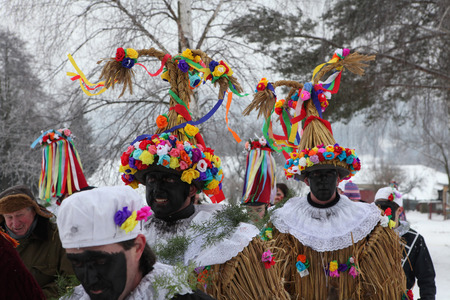 attend: VITANOV, CZECH REPUBLIC - JANUARY 26, 2013: People attend the Masopust Carnival, a traditional ceremonial Shrovetide door-to-door procession in Vitanov near Pardubice, Czech Republic.