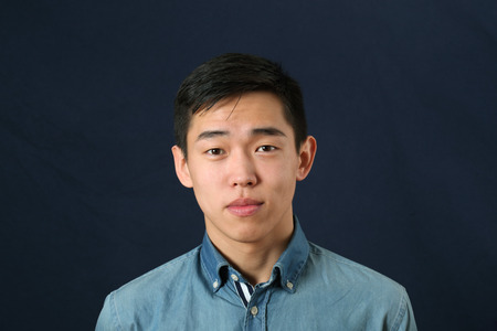 young man smiling: Romanic young Asian man looking at camera