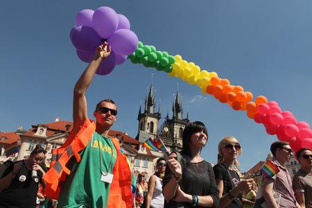 attend: PRAGUE, CZECH REPUBLIC - AUGUST 17, 2013: People attend the Prague Gay Pride Festival in Prague, Czech Republic.
