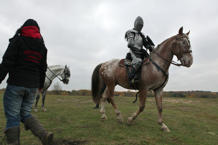 cavalryman: MILOVICE, CZECH REPUBLIC - OCTOBER 23, 2013: Actor dressed as a medieval knight rides a horse during the filming of the new movie The Knights directed by Carsten Gutschmidt near Milovice, Czech Republic.