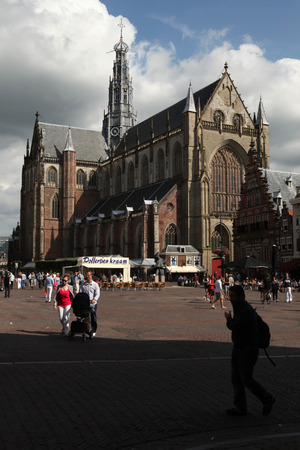 north holland: HAARLEM, NETHERLANDS - AUGUST 9, 2012: People walk in front of the Grote Kerk (Great Church) on the Grote Markt in Haarlem, North Holland, Netherlands. Editorial
