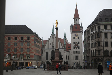 old town hall: MUNICH, GERMANY - MARCH 4, 2012: People in front of the Altes Rathaus (Old Town Hall) in Marienplatz Square in Munich, Bavaria, Germany. Editorial
