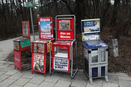 media distribution: MUNICH, GERMANY - MARCH 4, 2012: Newspaper vending machines in Munich, Bavaria, Germany.