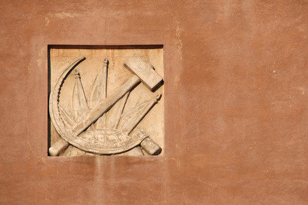 an era: Hammer and Sickle. Stucco decoration from the Soviet era on the building in Yekaterinburg, Russia. Editorial
