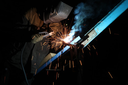 welds: UKRAINE, KIEV - JUNE 6, 2011: Welding operator welds metal constructions in Kiev, Ukraine.
