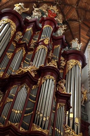 pipe organ: HAARLEM, NETHERLANDS - AUGUST 9, 2012: Pipe organ in the Grote Kerk (Great Church) on the Grote Markt in Haarlem, North Holland, Netherlands.