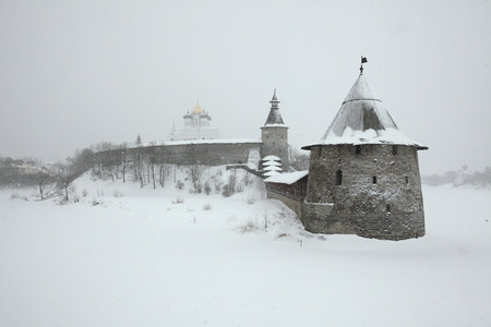 Russian winter. Ploskaya (Flat) Tower and Kutekroma Tower of the Pskov Kremlin (Krom) and the Trinity Cathedral in Pskov, Russia. photo