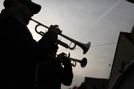brass  band: TURNOW, GERMANY - MARCH 12, 2011: Local brass band attends the Zampern Carnival in the Lusatian village of Turnow near Cottbus, Lower Lusatia, Brandenburg, Germany. Stock Photo