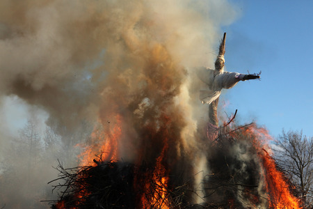 lower lusatia: BURG, GERMANY - APRIL 7, 2012: Straw doll symbolizing winter is burned at the traditional Easter bonfire in the Lusatian village of Burg in Spreewald Region, Lower Lusatia, Brandenburg, Germany. Editorial
