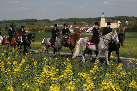 ceremonial: CROSTWITZ, GERMANY - APRIL 24, 2011: Easter Riders attend the Easter ceremonial equestrian procession in the Lusatian village of Crostwitz near Bautzen, Upper Lusatia, Saxony, Germany.