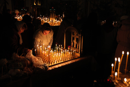liturgy: PSKOV, RUSSIA - JANUARY 18, 2011: Orthodox believers light candles during the Epiphany evening service in the Church of Saint Alexander Nevsky in Pskov, Russia. Editorial