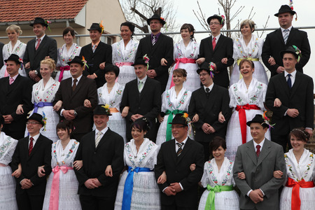 ceremonial clothing: TURNOW, GERMANY - MARCH 13, 2011: Young people in Sorbian costumes attend the Zapust Carnival in the Lusatian village of Turnow near Cottbus, Lower Lusatia, Brandenburg, Germany. Editorial