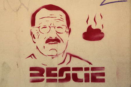 klaus: PRAGUE, CZECH REPUBLIC - SEPTEMBER 9, 2012: Czech president Vaclav Klaus depicted in a street graffiti in Prague, Czech Republic. Text in Czech language means: Beast.