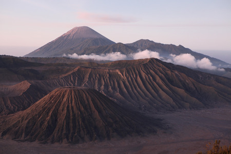 Sunrise over the volcanoes of the Tengger Caldera in East Java, Indonesia, pictured from Mount Penanjakan (2,770 m). Stock Photo