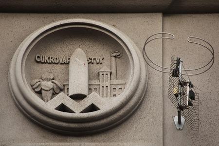 allegory: Allegory of Sugar Industry. Building decoration at Bubenecska Street in Prague, Czech Republic.