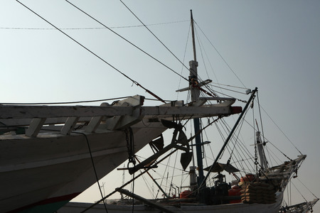 JAKARTA, INDONESIA - AUGUST 16, 2011: Wooden sailing ships called pinisi in the historical port of Sunda Kelapa in Jakarta, Central Java, Indonesia. Stok Fotoğraf - 38895268