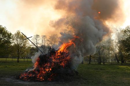 burg: BURG, GERMANY - APRIL 23, 2011: Traditional Easter bonfire in the Lusatian village of Burg in Spreewald Region, Lower Lusatia, Brandenburg, Germany.