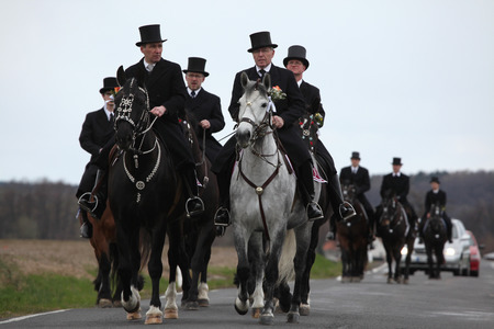 CROSTWITZ, GERMANY - APRIL 8, 2012: Easter Riders attend the Easter ceremonial equestrian procession in the Lusatian village of Crostwitz near Bautzen, Upper Lusatia, Saxony, Germany.