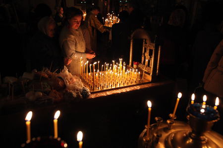 liturgical: PSKOV, RUSSIA - JANUARY 18, 2011: Orthodox believers light candles during the Epiphany evening service in the Church of Saint Alexander Nevsky in Pskov, Russia. Editorial