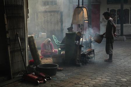 SURAKARTA, INDONESIA - AUGUST 17, 2011: Vendors prepare and sell street food in Surakarta, Central Java, Indonesia.
