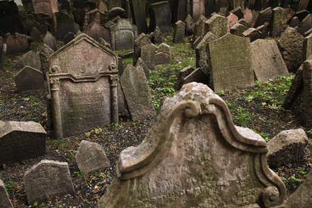 hebrew script: Abandoned tombstones at the Old Jewish Cemetery in Prague, Czech Republic.