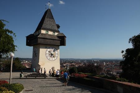 grazer: GRAZ, AUSTRIA - SEPTEMBER 3, 2011: People enjoy panoramic views from near the Uhrturm (Clock Tower) on the Grazer Schlossberg (Castle Hill) in Graz, Styria, Austria.