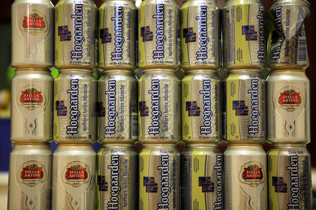 leuven: LEUVEN, BELGIUM - AUGUST 22, 2012: Empty beverage cans after Belgian beer Hoegaarden and Stella Artois pictured in Leuven, Belgium.