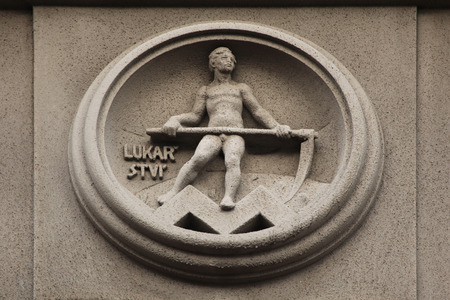 modernist: Allegory of Haying. Building decoration at Bubenecska Street in Prague, Czech Republic.