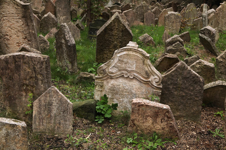 hebrew script: Abandoned tombstones at the Old Jewish Cemetery in Prague Czech Republic. Stock Photo