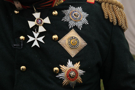austerlitz: TVAROZNA, CZECH REPUBLIC  DECEMBER 3, 2011: Russian imperial military decorations seen fixed on uniform during the re-enactment of the Battle of Austerlitz (1805) near Tvarozna, Czech Republic.