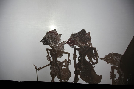 wayang: YOGYAKARTA, INDONESIA - AUGUST 13, 2012: Traditional Indonesian shadow puppet theatre wayang kulit performs in the Sasono Hinggil Theatre in Yogyakarta, Central Java, Indonesia. Editorial