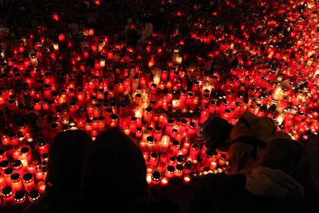 PRAGUE, CZECH REPUBLIC - DECEMBER 22, 2011: People light candles in memoriam late Czech president Vaclav Havel in Wenceslas square in Prague, Czech Republic. Editorial