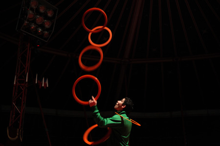 rehearse: PRAGUE, CZECH REPUBLIC - NOVEMBER 20, 2011: Czech juggler Michal Bados rehearses in the Humberto Circus in Prague, Czech Republic.