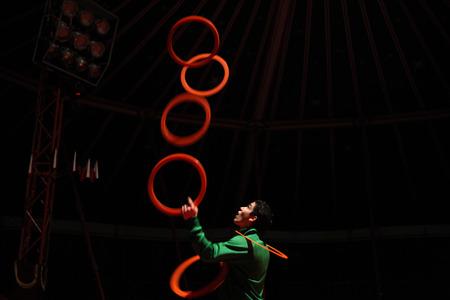PRAGUE, CZECH REPUBLIC - NOVEMBER 20, 2011: Czech juggler Michal Bados rehearses in the Humberto Circus in Prague, Czech Republic.