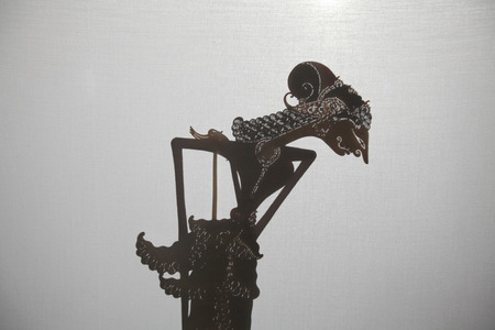 YOGYAKARTA, INDONESIA - AUGUST 14, 2012: Traditional Indonesian shadow puppet theatre wayang kulit performs in the Sasono Hinggil Theatre in Yogyakarta, Central Java, Indonesia.