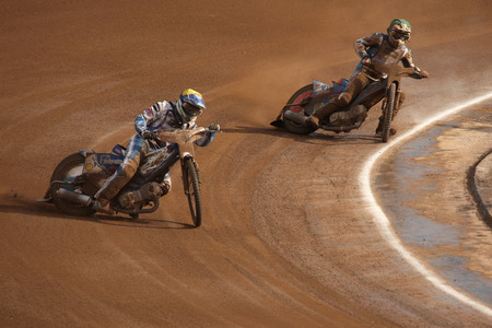 PARDUBICE, CZECH REPUBLIC - OCTOBER 14, 2012: Speedway riders compete on track during the Golden Helmet Prix in Pardubice, Czech Republic. Editorial